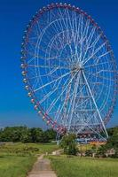 Ferris wheel at the amusement park with blue sky photo