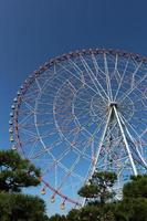 Ferris wheel with blue sky at the amusement park photo