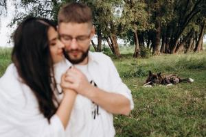 Young couple in love a guy with a beard and a girl with dark hair in light clothes photo