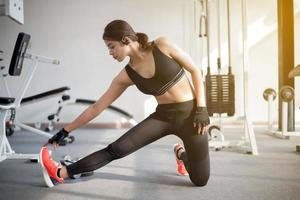 Woman stretching in the gym photo