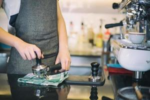 Barista making espresso drinks photo