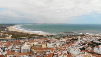 Lagos cityscape and Atlantic ocean sand beach, Algarve. Aerial view video