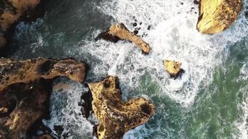 Bird's eye view of Algarve rocky cliffs and rugged coastline, Ponta da Piedade, Lagos Portugal - Aerial shot video