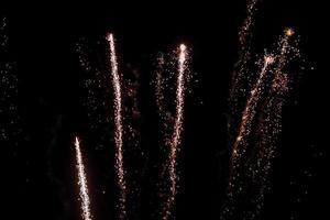 Real fireworks on deep black background sky photo