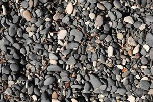 Pebbles on the beach as background photo