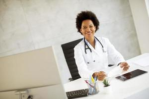 Doctor posed at desk photo