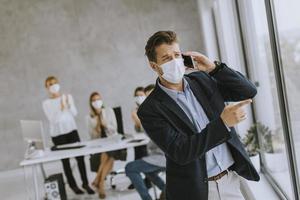 Masked man on phone photo