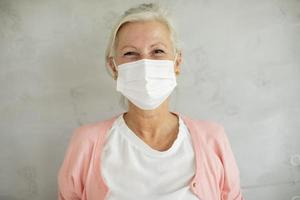 Close-up of a masked mature woman photo