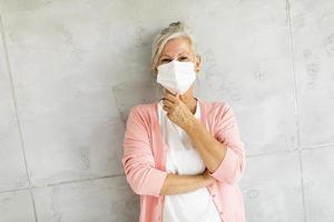 Masked mature woman photo