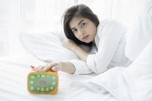 Asian woman waking up photo