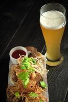 Glass of cold beer with appetizer catering menu photo