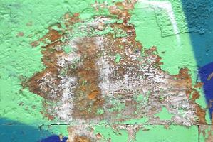 Graffiti with peeling paint photo