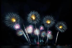Festive beautiful colorful fireworks display on the sea beach Amazing holiday fireworks party or any celebration event in the dark sky photo