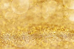 Gold dust elegant with bokeh Abstract or texture background photo