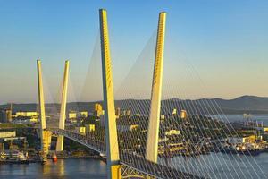 Golden bridge is a landmark of the city at sunset photo