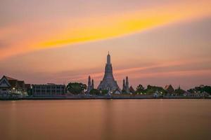 Wat Arun Ratchawaram Ratchaworamawihan at sunset twilight sky Bangkok Thailand photo