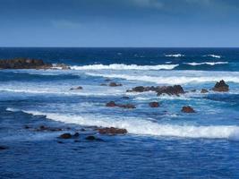Waves and rocky shore at Puerto de la Cruz Tenerife Canary Islands photo
