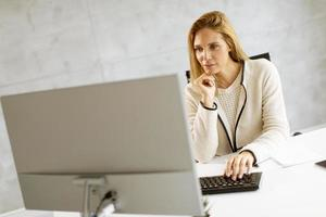 Businesswoman working on a computer photo