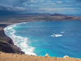 View over Famara beach and bay Lanzarote Canary Islands photo