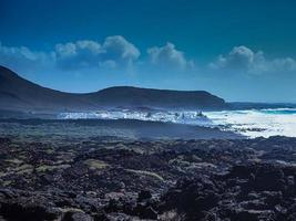 View of El Golfo and the black volcanic coast of Lanzarote Canary Islands photo