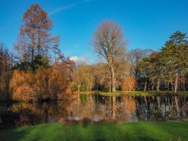 Reflections in a lake in Wilhelminapark Utrecht Netherlands on a beautiful winter day photo