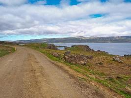Gravel road in the Westfjords of Iceland photo
