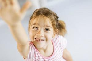 Girl rising hand photo