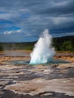 Strokkur geyser beginning to erupt at Geysir Iceland photo