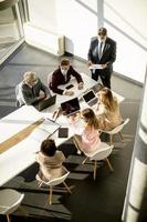 Vertical view of a meeting in a modern office photo