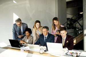 Group of business people preparing new project photo