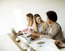 Three businesswomen in a meeting photo