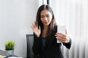 The young businesswoman is conference With people who work with use smartphone photo