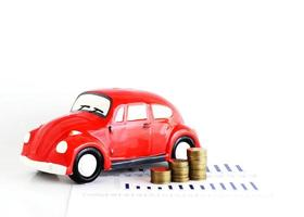 Red car bank and coins stack for car loans concept photo