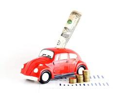 Dollar banknote into car bank and coins stack for loan money concept photo