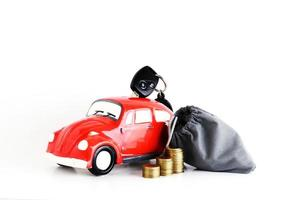 Car bank and money bag with coins stack for car loan concept photo