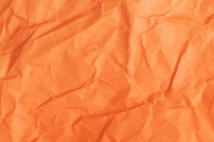 Abstract background texture with orange color paper sheet photo