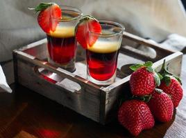 Shot glasses with strong alcohol on a tray photo