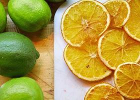 Sliced green lime and yellow lemon slices photo