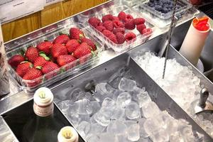 Berries and fruits in the bar and ice photo