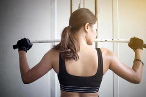 Woman working out in the gym photo