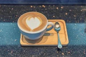 Cappuccino coffee cup on wood table photo