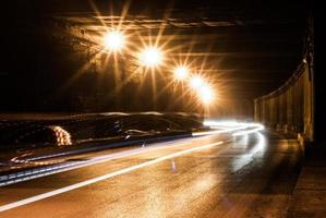 Old tunnel with bright light trails photo