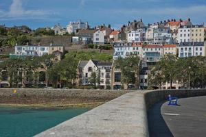 Scenic view of a bay in Saint Peter Port in Guernsey Channel Islands UK photo