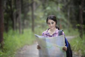 Female hiker looking at map photo