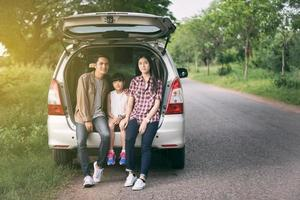 Family taking pit stop on road trip photo