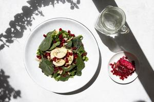 Spinach salad with water photo