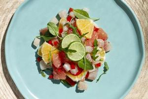 Ceviche plate with lime and raw fish photo