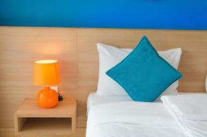 Blue cushions in bedroom photo
