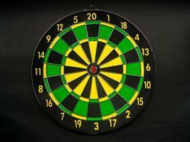 Darts board on black background photo
