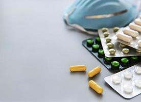 Blue medical mask and medicine pills photo
